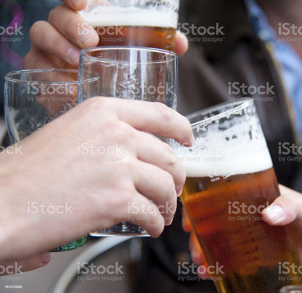 cheers with beer - Biergläser beim anstoßen royalty-free stock photo
