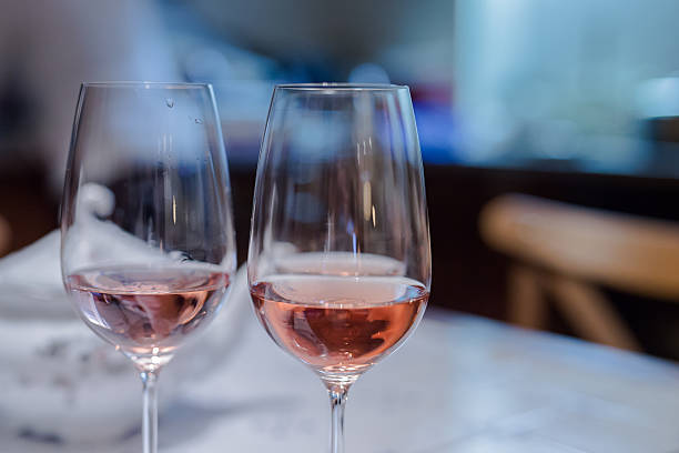Cheers with pair of wine glasses stock photo