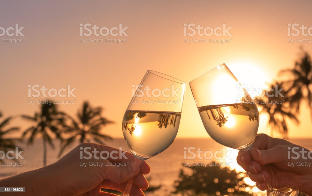 Cheers with wine glasses in a beautiful sunset setting - fotografia de stock