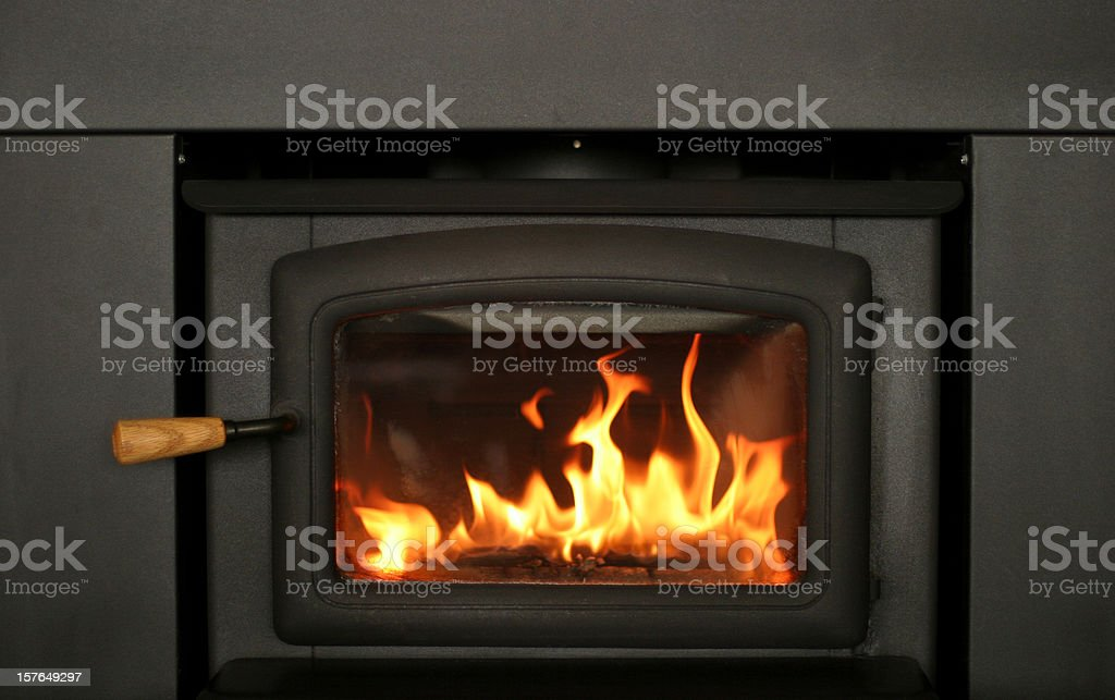 Cheery Fire Burning in Fireplace Insert stock photo