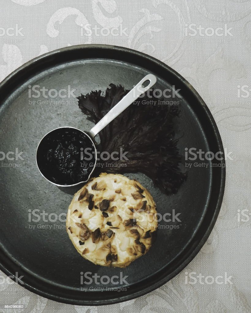Chees with jam on black plate royalty-free stock photo