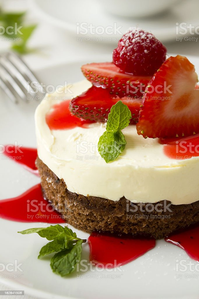 Cheescake with strawberries stock photo