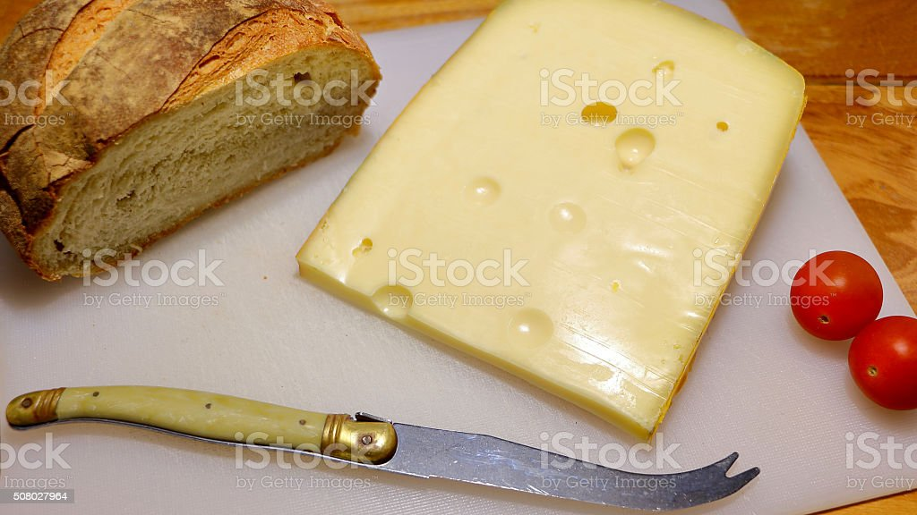 Cheese and bread with tomatoes stock photo