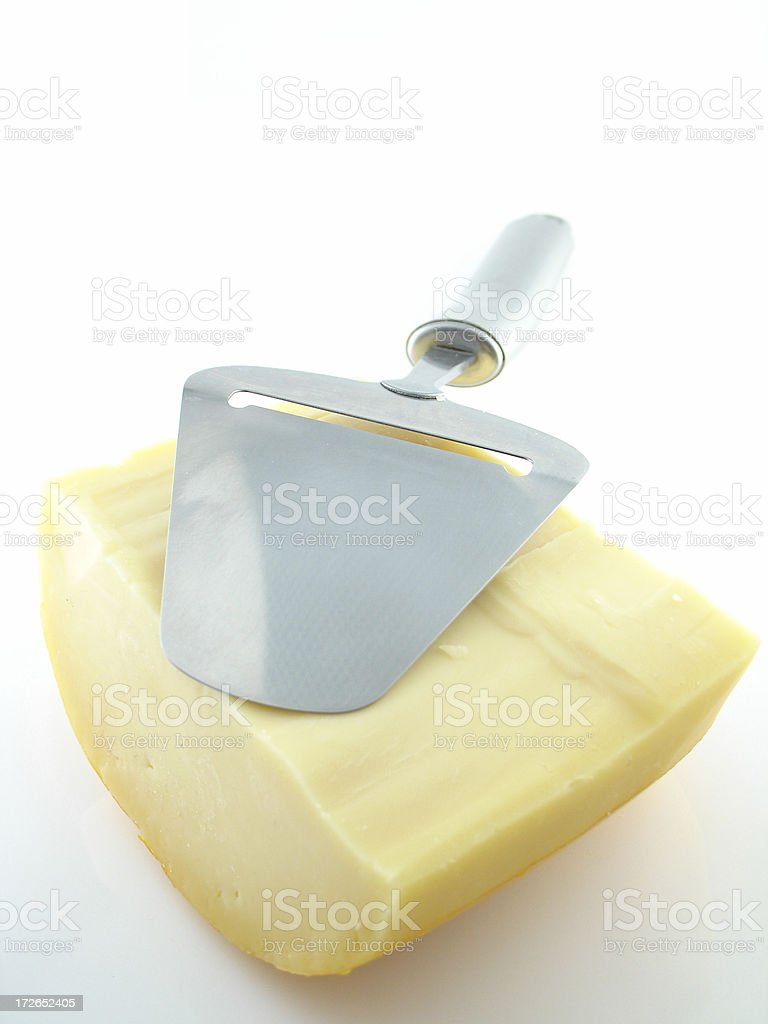 Cheese and Cheeseslicer royalty-free stock photo