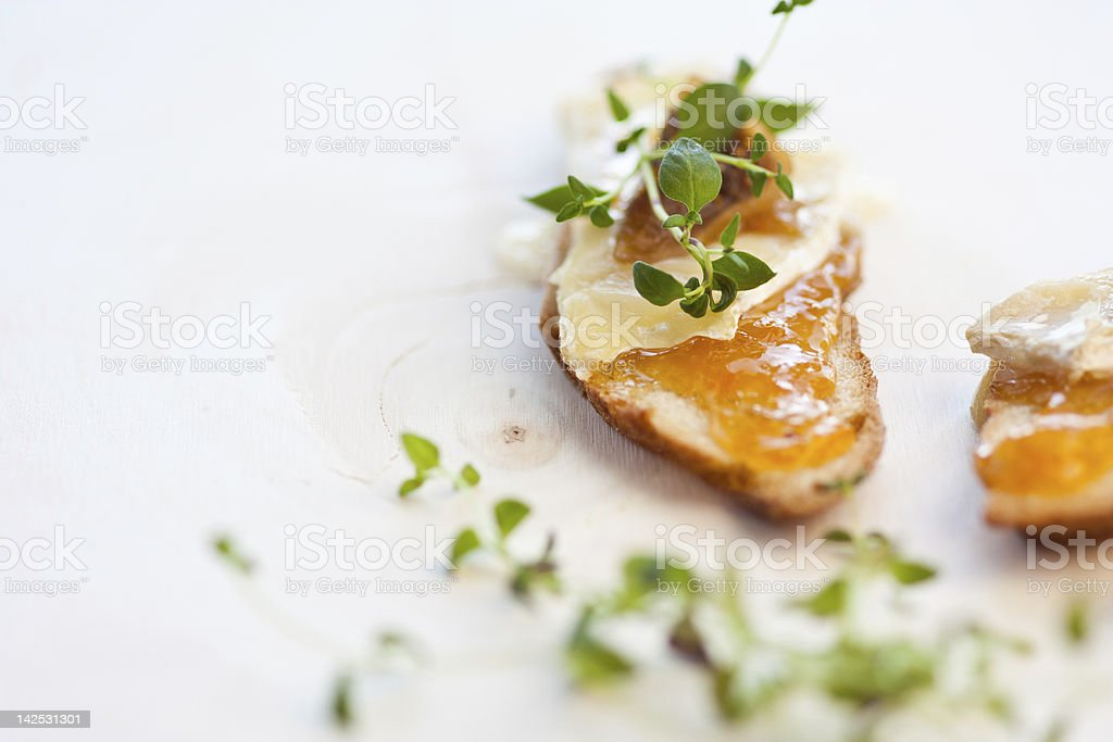 cheese and chutney crostini with thyme royalty-free stock photo
