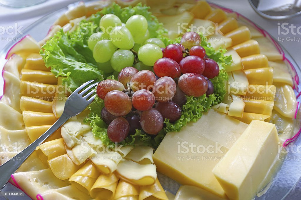 Cheese and grapes served on a brunch royalty-free stock photo