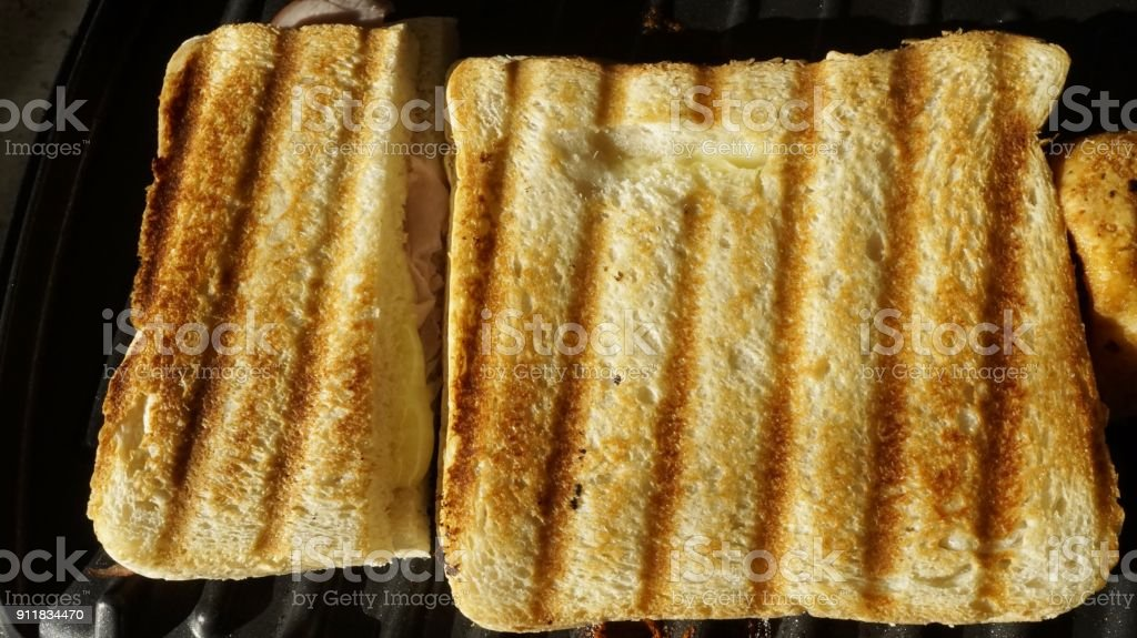 Cheese and Ham Toasted Sandwich stock photo