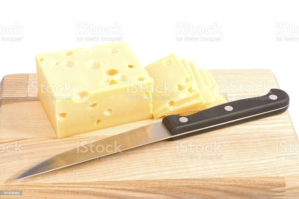 Cheese and knife on cutting board stock photo