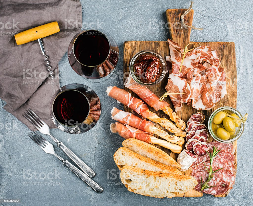 Cheese and meat appetizer selection or wine snack set. Variety stock photo