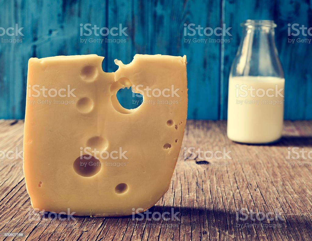 cheese and milk on a rustic wooden table stock photo