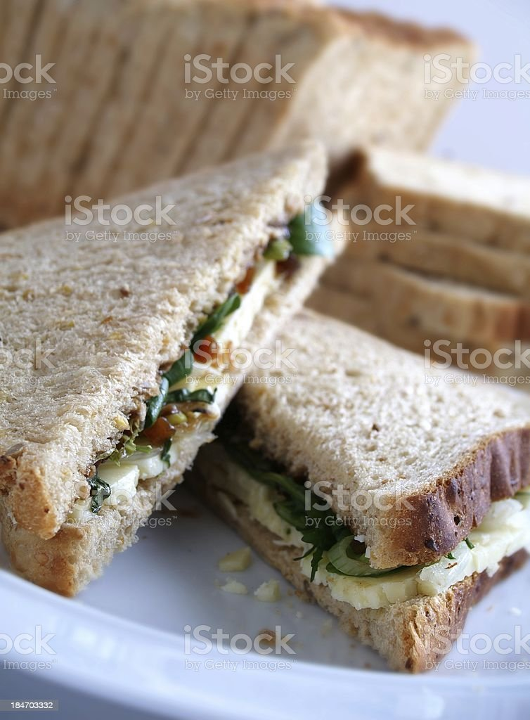 cheese and pickle sandwiches prepared on plate stock photo