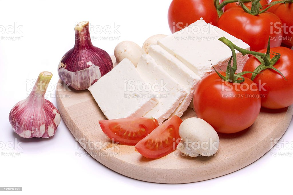 Cheese and tomato on white background royalty-free stock photo