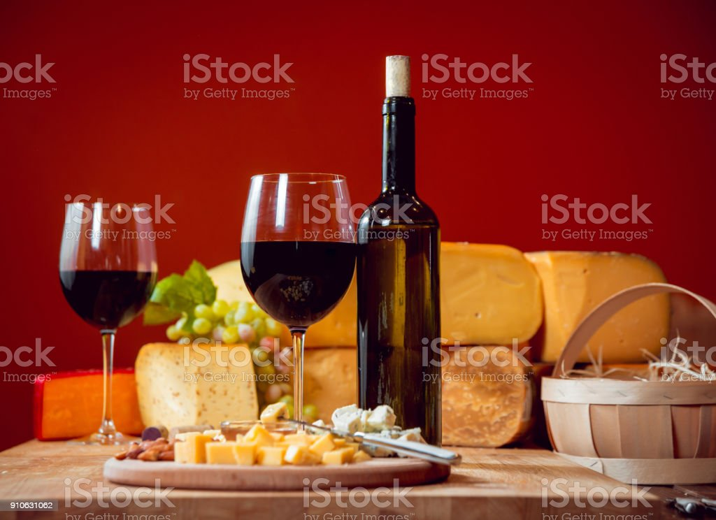 Cheese and wine on a dark table. stock photo