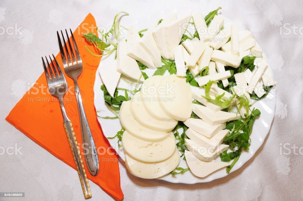 Cheese assortment plate with orange napkin stock photo