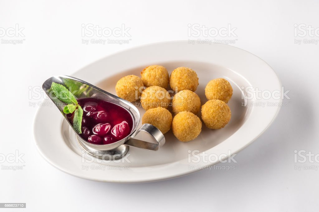 Cheese balls appetizers with sauce on a white plate royalty-free stock photo