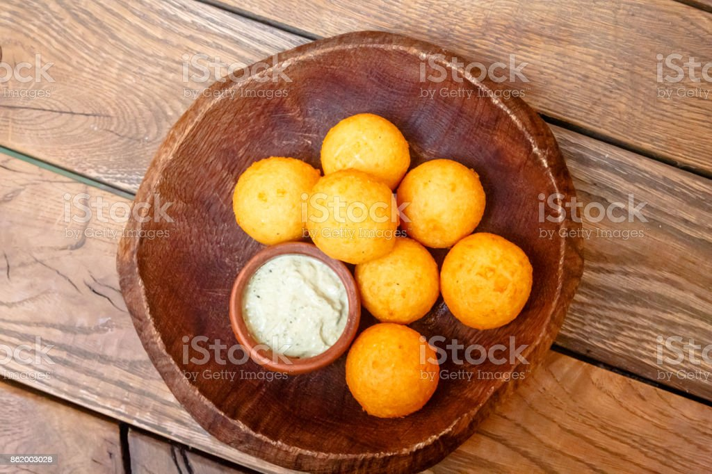 Cheese balls breaded lie on a wooden plate. royalty-free stock photo & Cheese Balls Breaded Lie On A Wooden Plate Stock Photo u0026 More ...