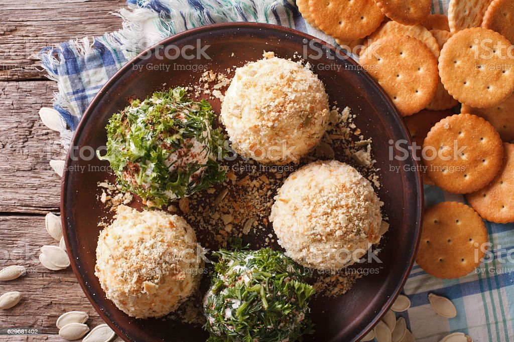 Cheese balls with crackers, herbs and seeds close-up. horizontal - foto de acervo