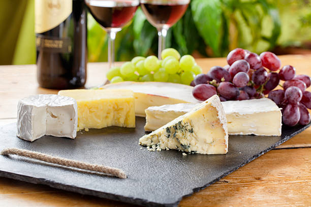 Cheese board and red wine stock photo