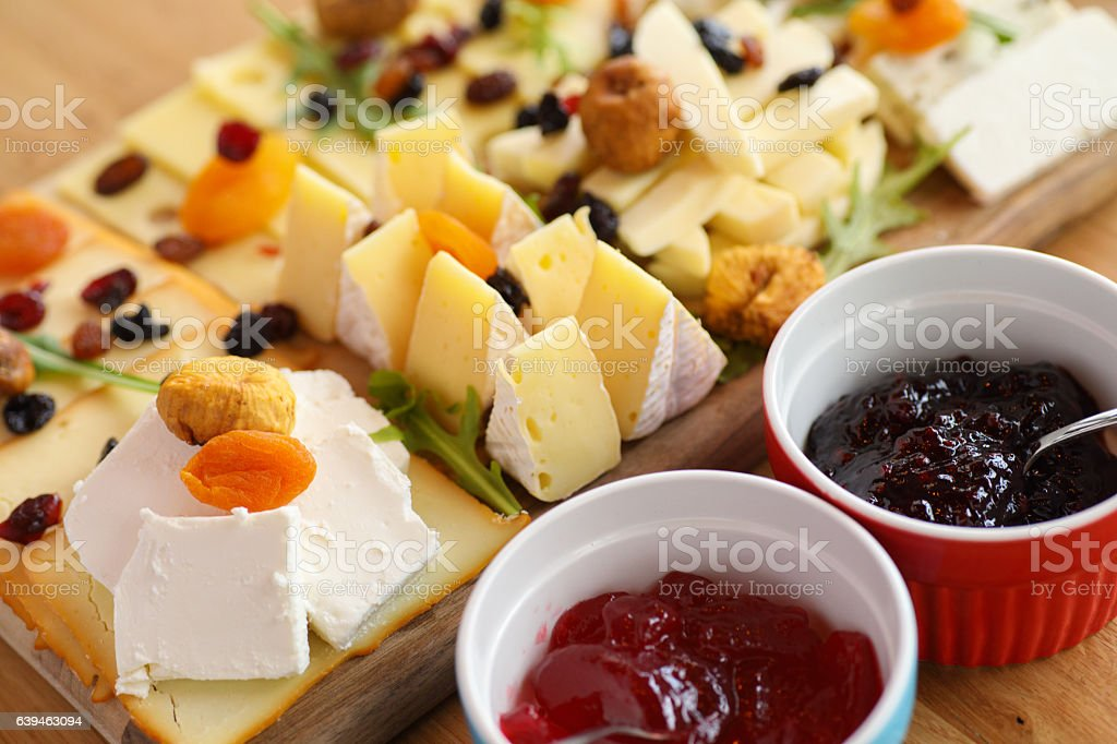 Cheese board with various types cheese and jam stock photo