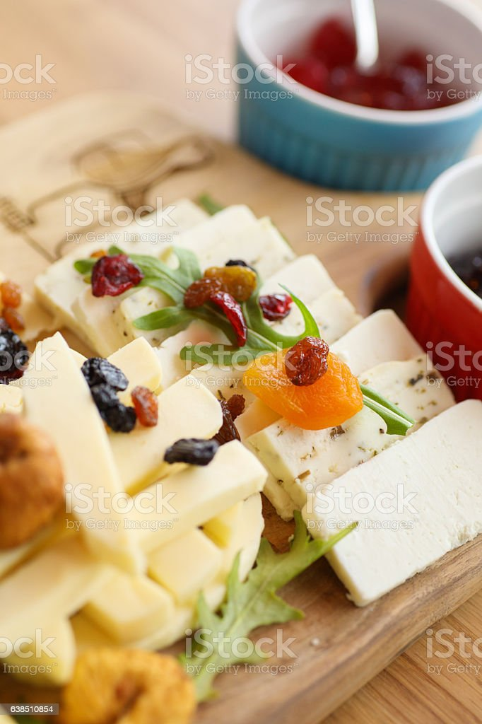 Cheese board with various types of cheese and jam stock photo