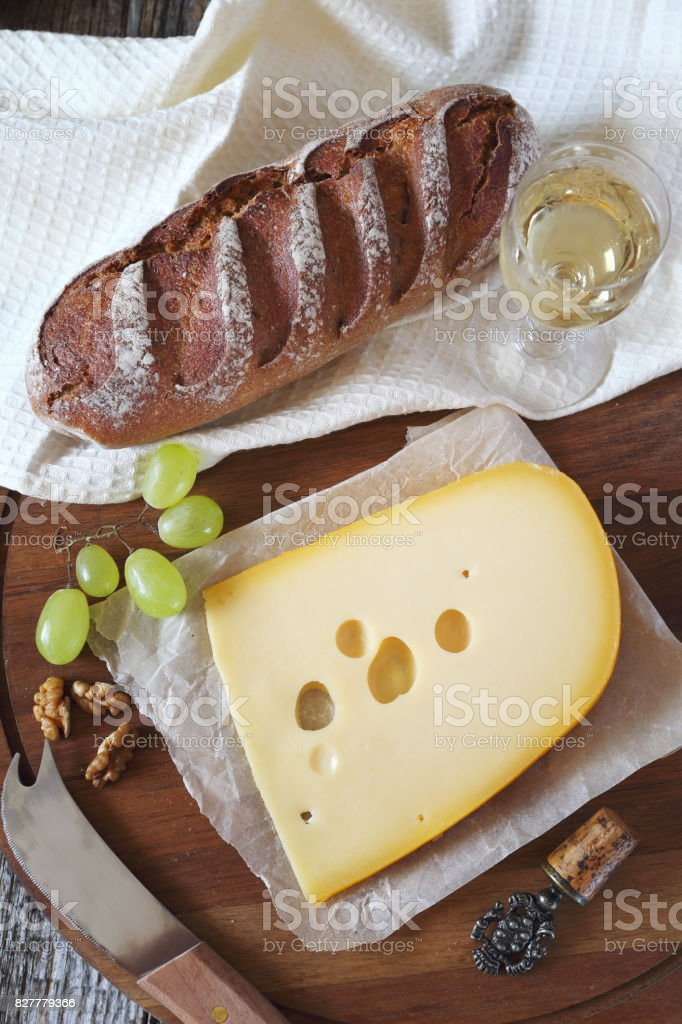 Cheese, bread, grapes and white wine stock photo