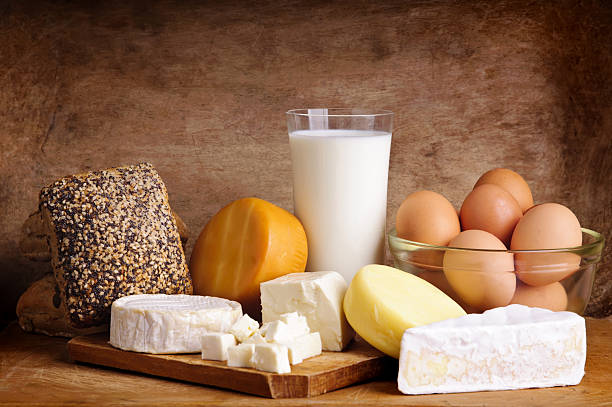 cheese, bread, milk and eggs stock photo