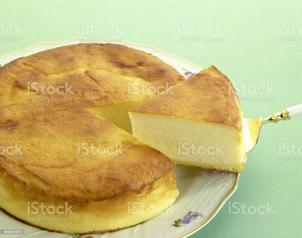Cheese cake on a cake server, cut off stock photo