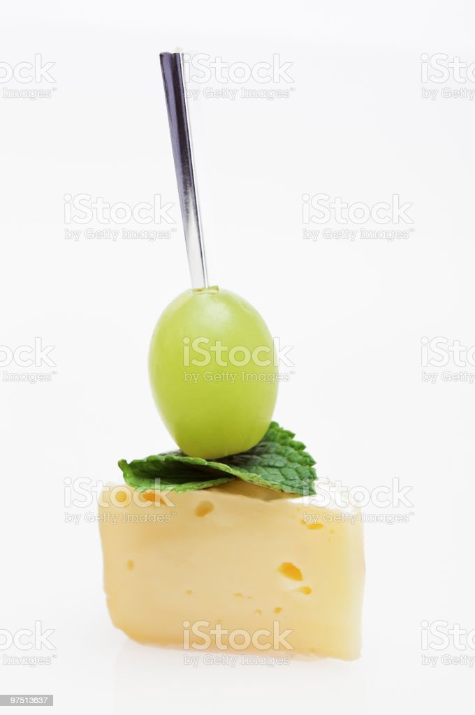 Cheese canape with grape and mint royalty-free stock photo