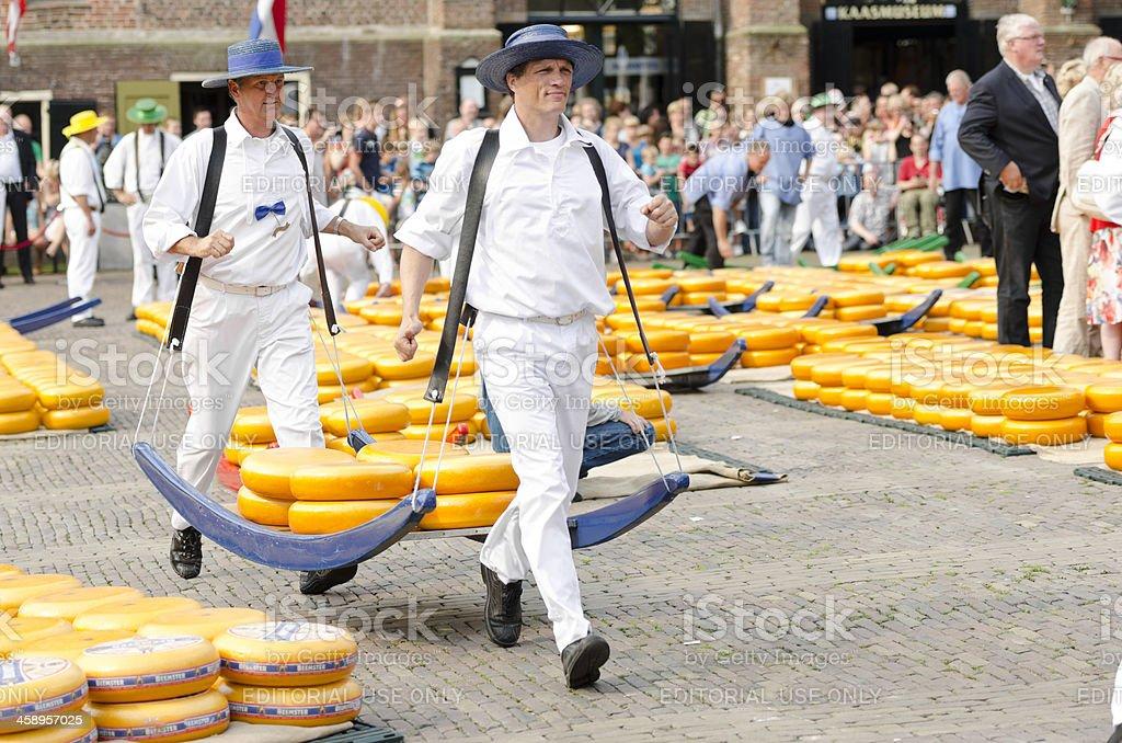 Cheese carriers in Alkmaar stock photo