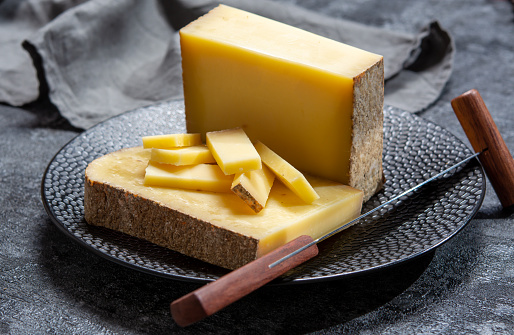 Cheese collection, French hard comte cheese made from cow milk in region Franche-Comte, France close up