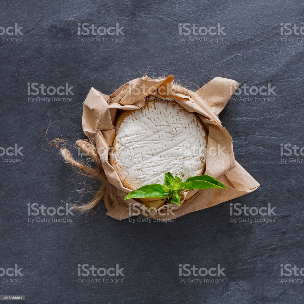Cheese delikatessen closeup on black stone surface, brie camembert stock photo