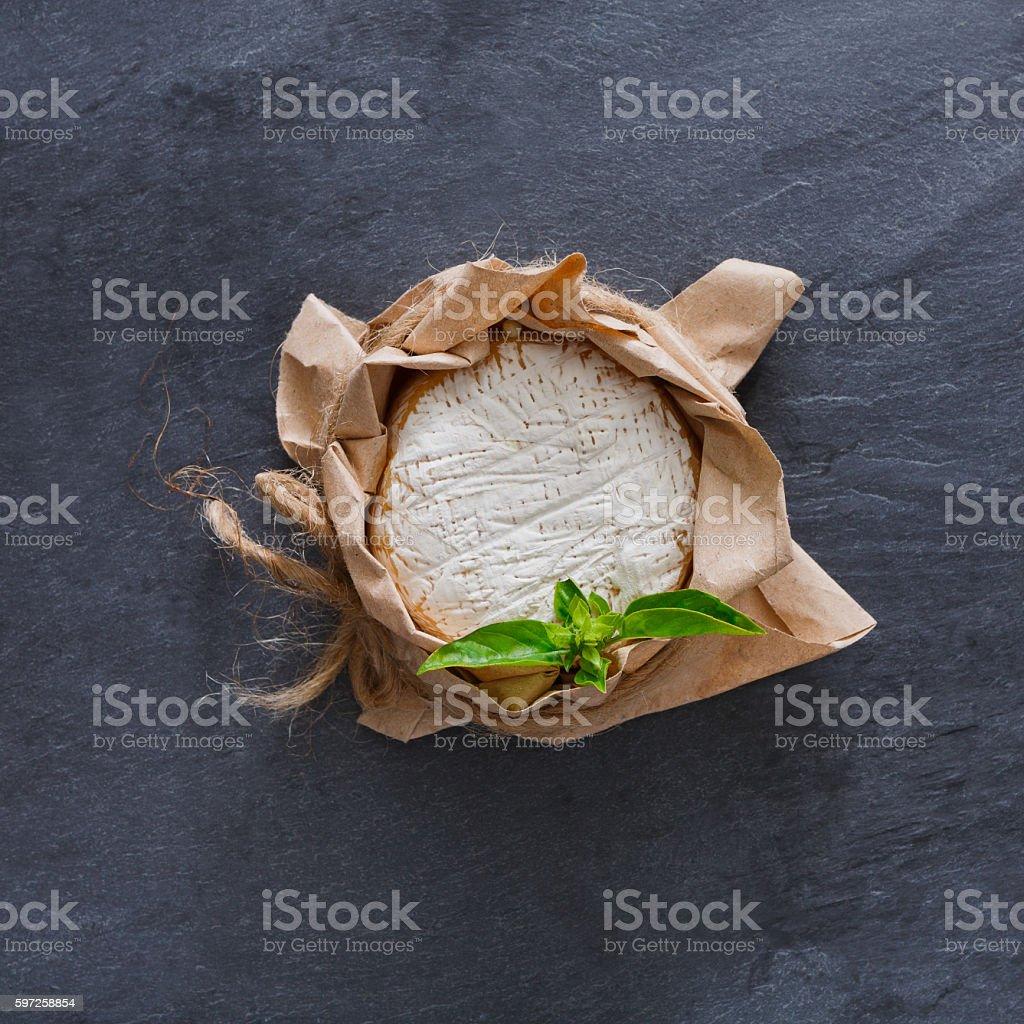 Cheese delikatessen closeup on black stone surface, brie camembert - Photo