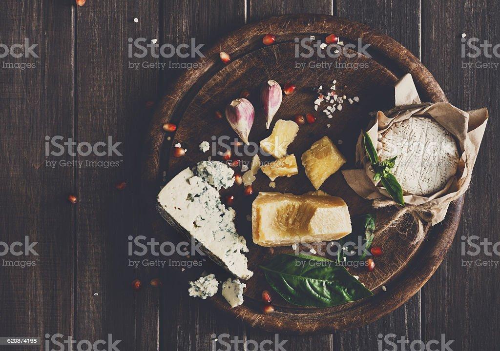 Cheese delikatessen on rustic wood, blue roquefort, brie and parmesan zbiór zdjęć royalty-free