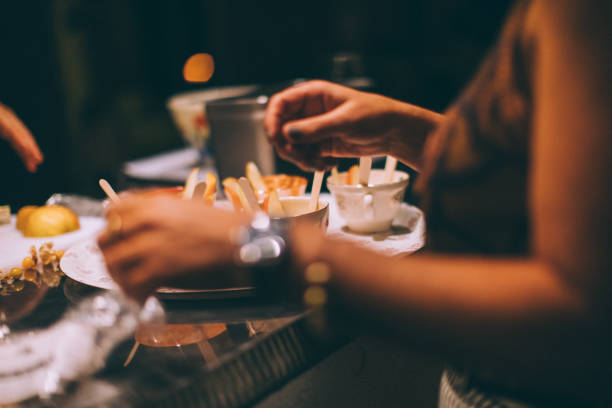 Cheese fondue in porcelain cups stock photo