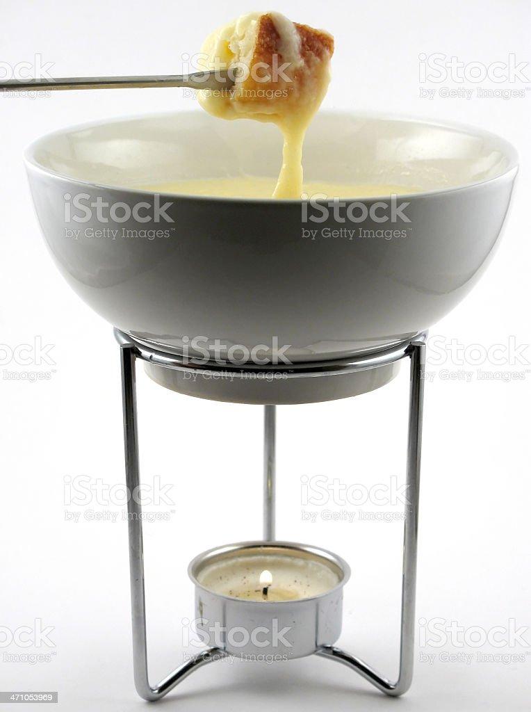Cheese fondue in pot stock photo