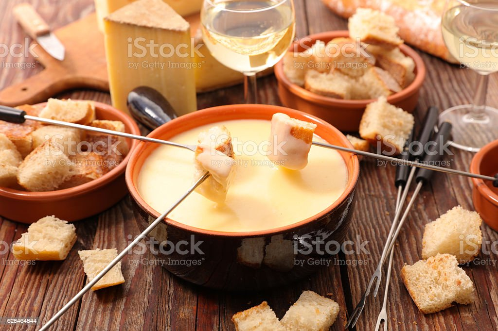 cheese fondue swiss stock photo