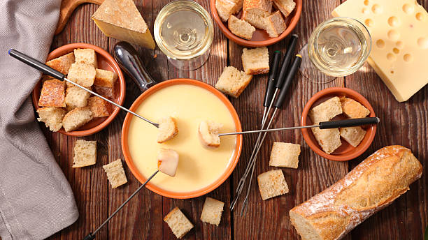 cheese fondue swiss - fondue stock-fotos und bilder
