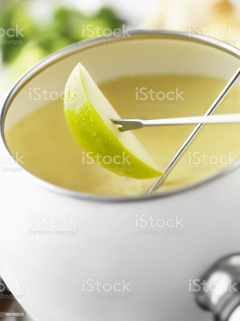 Cheese Fondue with Green Apples stock photo