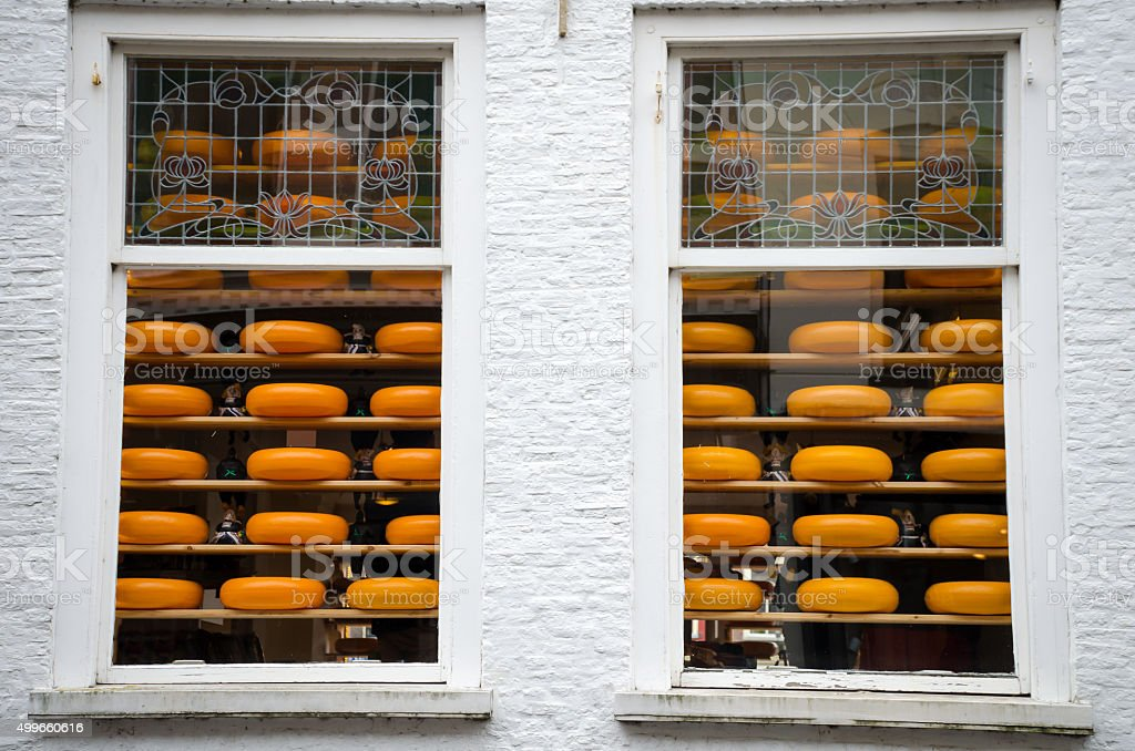 Cheese for sale behind two windows stock photo