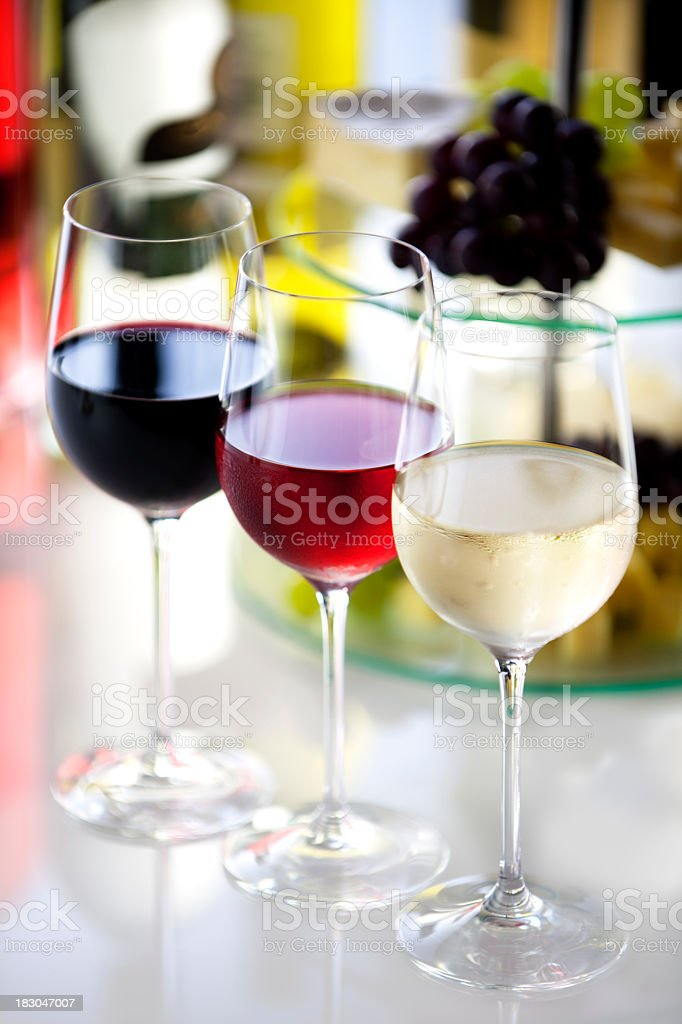 Cheese, grapes and 3 glasses of wine in different colors royalty-free stock photo