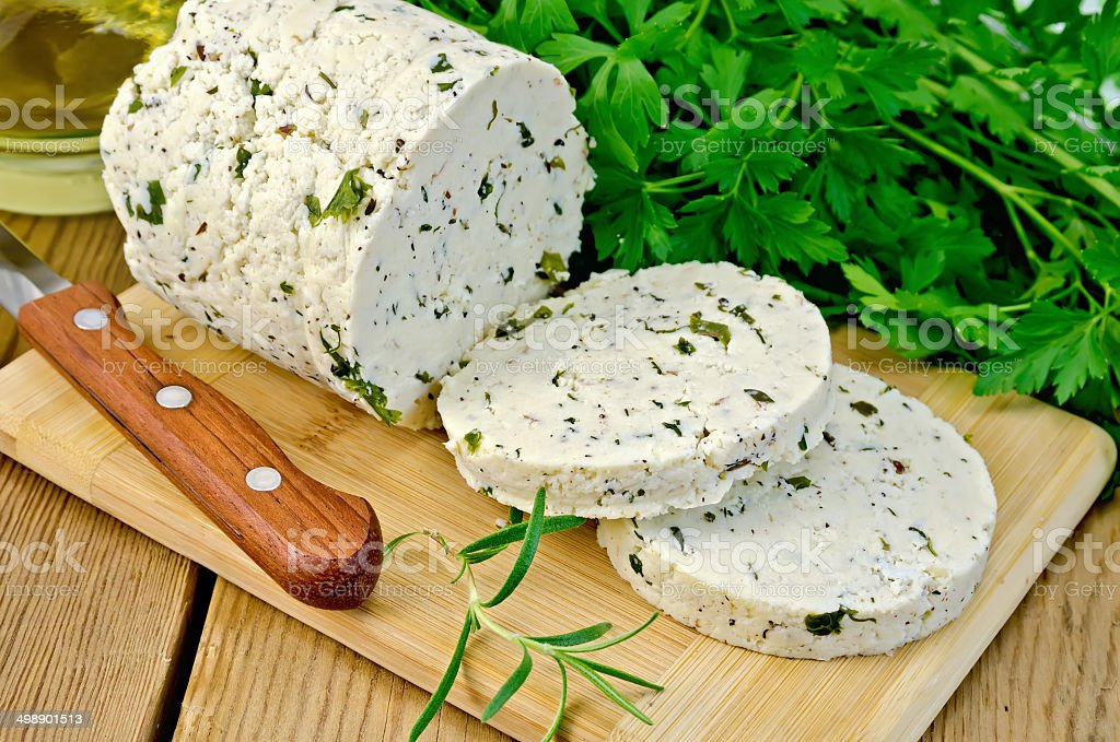 Cheese homemade with herbs cut on a board royalty-free stock photo