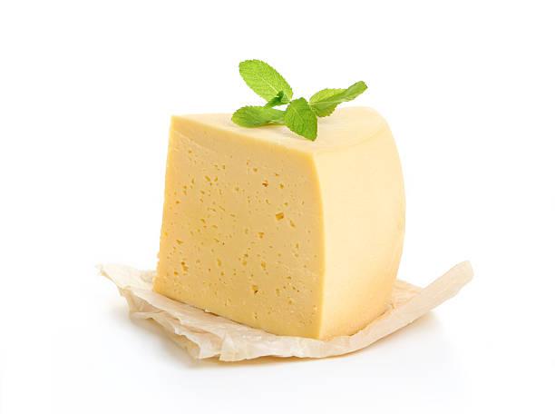 formaggio isolato su sfondo bianco  - maasdam foto e immagini stock