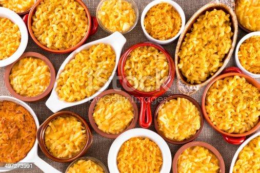 istock Cheese macaroni served conceptually on table cloth 497273991
