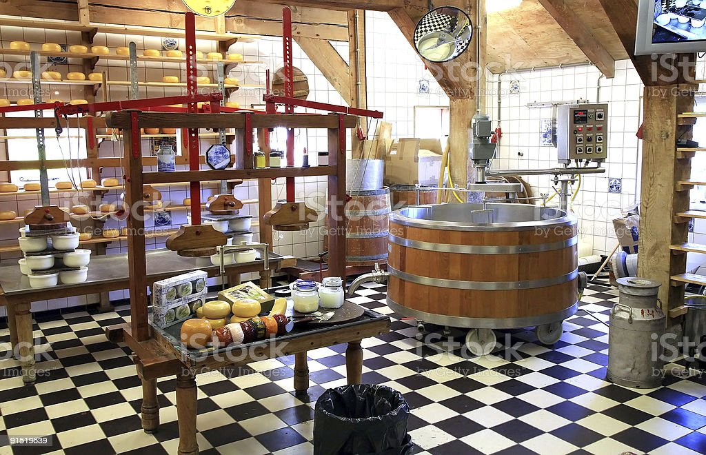 Cheese manufacture in Netherlands. stock photo