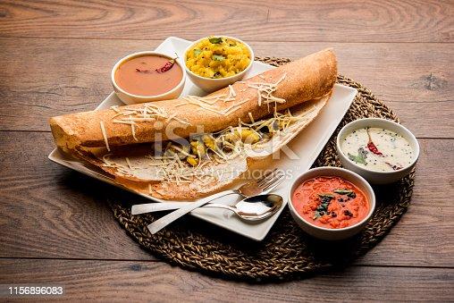 cheese masala dosa recipe with sambar and chutney, selective focus