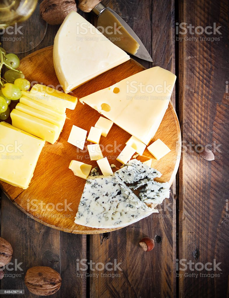 Cheese, nuts and grapes stock photo