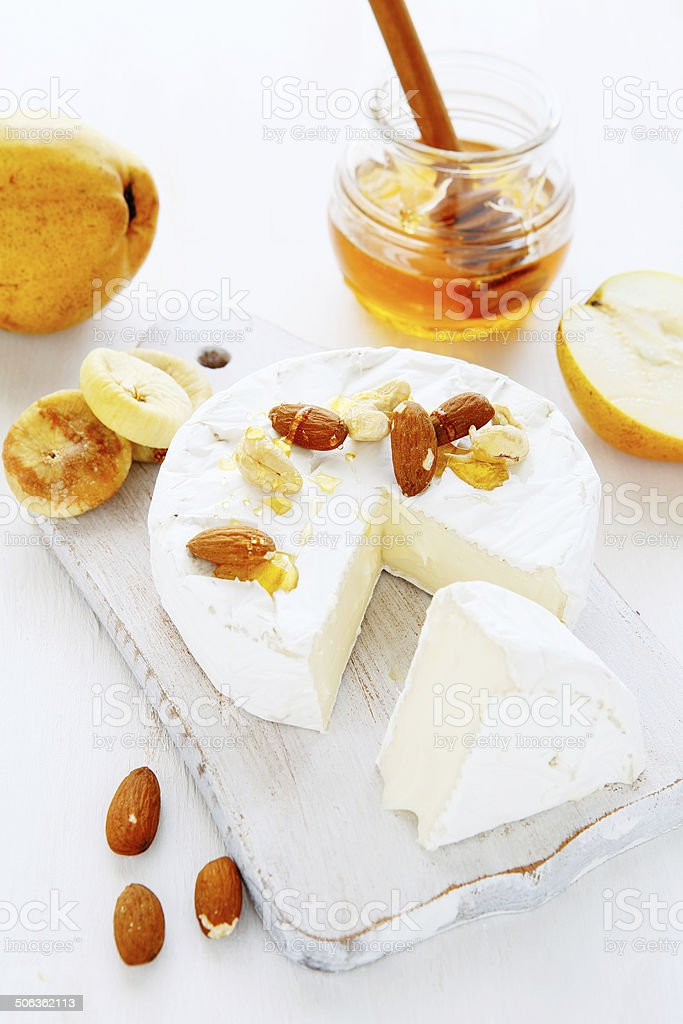 cheese, nuts and honey on the board stock photo
