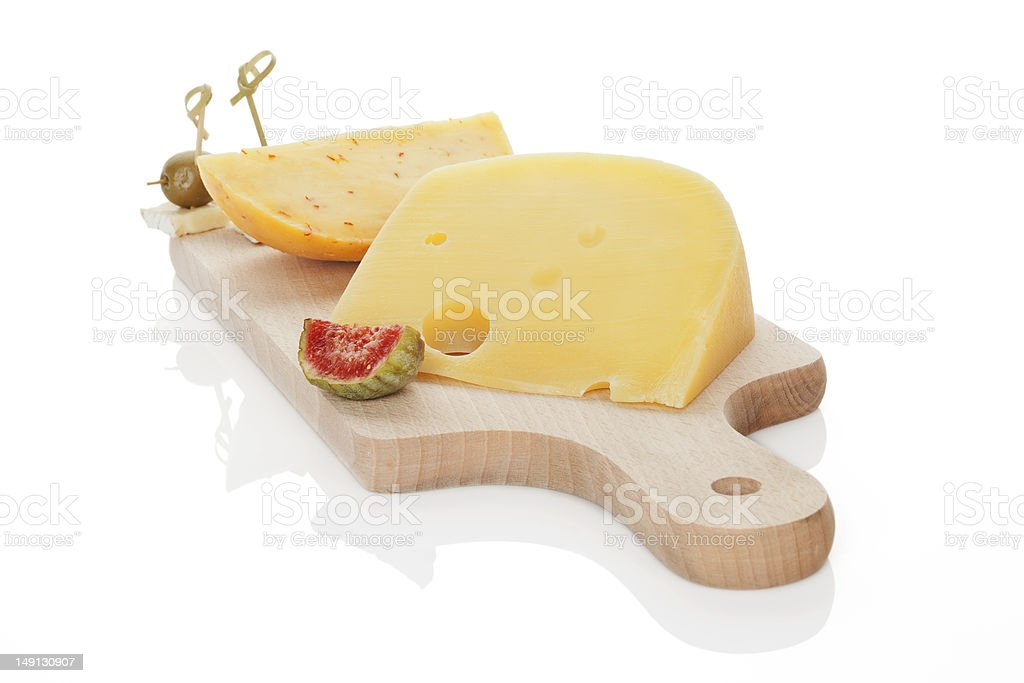 Cheese on chopping board isolated. stock photo