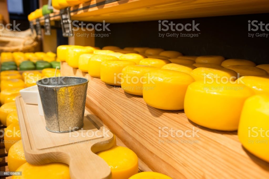 Cheese on shelves stock photo