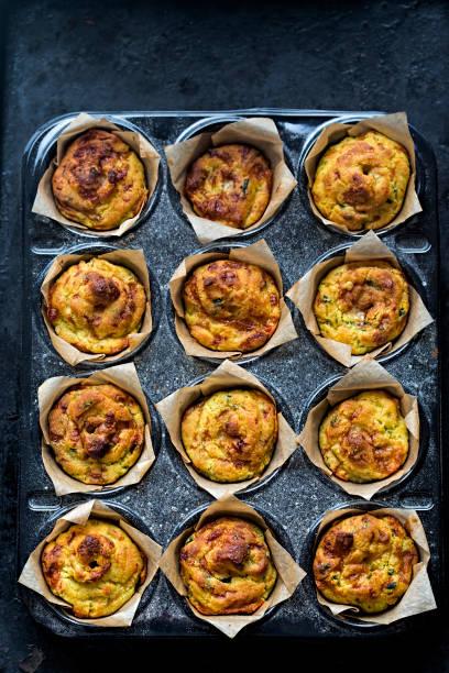 cheese onion mini muffin - käsemuffins stock-fotos und bilder
